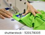 hands seamstress at work. logo... | Shutterstock . vector #520178335