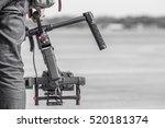Videographer with gimball video DSLR - stock photo