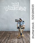 Small photo of Little director with a megaphone in studio