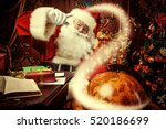 Santa Claus At Home Reading Th...