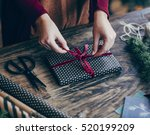 woman tying ribbon on christmas ... | Shutterstock . vector #520199209