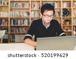young pensive asian man working ... | Shutterstock . vector #520199629