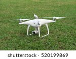 Small photo of Pattaya,Thailand, AUGUST 28, 2016: Airborne radio controlled Phantom 4 quadcopter drone flying with a camera over lawn lawn