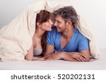 couple in a bed beloved together | Shutterstock . vector #520202131