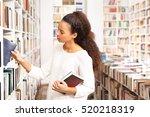 book. woman shopping in a... | Shutterstock . vector #520218319