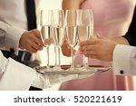 waiter serving champagne during ... | Shutterstock . vector #520221619