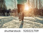 Woman Running At Snowly Winter...