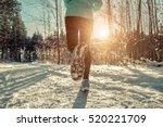 Woman Running At Snowly Winter...