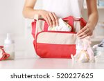 woman packing her bag with... | Shutterstock . vector #520227625