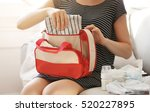 woman packing her bag with...   Shutterstock . vector #520227895