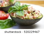 tuna stuffed avocado. avocado... | Shutterstock . vector #520229467