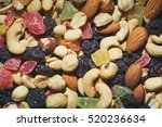 dried nuts and fruits background | Shutterstock . vector #520236634