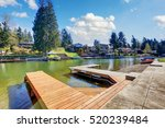 Private dock on the lake with a view of the homes, docks and boats on the other side. Northwest, USA