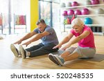 senior couple exercising in gym  | Shutterstock . vector #520248535