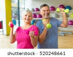 senior couple exercising in gym  | Shutterstock . vector #520248661
