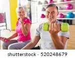 senior couple exercising in gym  | Shutterstock . vector #520248679