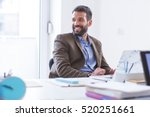 man working in office | Shutterstock . vector #520251661