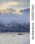 anchored yacht on lyngenfjord... | Shutterstock . vector #520257661
