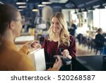 blonde girl paying in a... | Shutterstock . vector #520268587