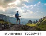 sporty man hiker on top of... | Shutterstock . vector #520269454