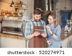 smiling handsome waiter holding ... | Shutterstock . vector #520274971