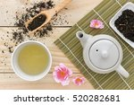 cup with green tea and teapot... | Shutterstock . vector #520282681