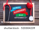 Small photo of World Alzheimer's Day, September 21st on chalkboard, stethoscope and red heart, health concepts.