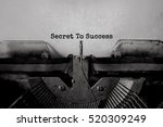 Small photo of Secret To Success typed words on a Vintage Typewriter.