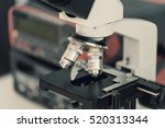 laboratory bench with microscope   Shutterstock . vector #520313344