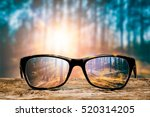 glasses focus background wooden ... | Shutterstock . vector #520314205