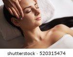 spa face massage. facial... | Shutterstock . vector #520315474