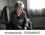 a worried senior woman at home... | Shutterstock . vector #520348207