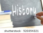 a person writing in a... | Shutterstock . vector #520354321