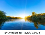 picturesque forest and the river | Shutterstock . vector #520362475