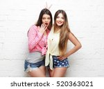 two young girl friends standing ... | Shutterstock . vector #520363021