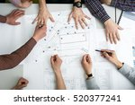 hands hold the white papers... | Shutterstock . vector #520377241