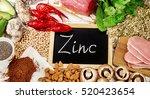 foods highest in zinc. top view | Shutterstock . vector #520423654
