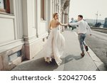 gorgeous wedding couple walking ... | Shutterstock . vector #520427065