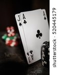 Small photo of Poker play. Ace of clubs and Ace of Diamonds Poker chips.
