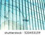 reflection of tower cranes... | Shutterstock . vector #520453159