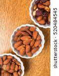 bowls of assorted nuts for a... | Shutterstock . vector #520484545
