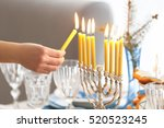 Female Hand Lighting Candles I...