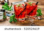red drink with ice. juice.... | Shutterstock . vector #520524619