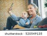 mom and toddler taking selfie... | Shutterstock . vector #520549135
