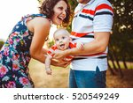 young and happy parents playing ... | Shutterstock . vector #520549249