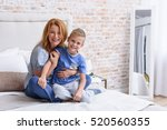 mother and little son being... | Shutterstock . vector #520560355