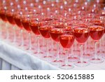 the glasses on the table. juice.... | Shutterstock . vector #520615885