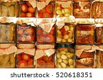 Small photo of many jars with preserved italian food with tomatoes and garlic and sardines in oil