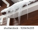 Icicles Hang From The Roof And...