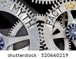 Small photo of Macro photo of tooth wheel mechanism with imprinted arrows and MYTH, FACT concept words